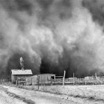 a huge cloud of dust engulfs a farm